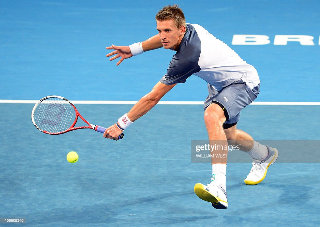 Jarkko Nieminen of Finland hits a backhand volley in his match against Alexandr Dolgopolov of Ukraine in the second round at the Brisbane International tennis tournament on January 2, 2013. AFP PHOTO/William WEST USE