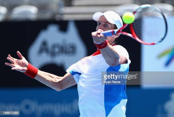 Jarkko Nieminen of Finland hits a forehand during his semi final match against Denis Istomin of Uzbekistan during day six of the 2012 Sydney...