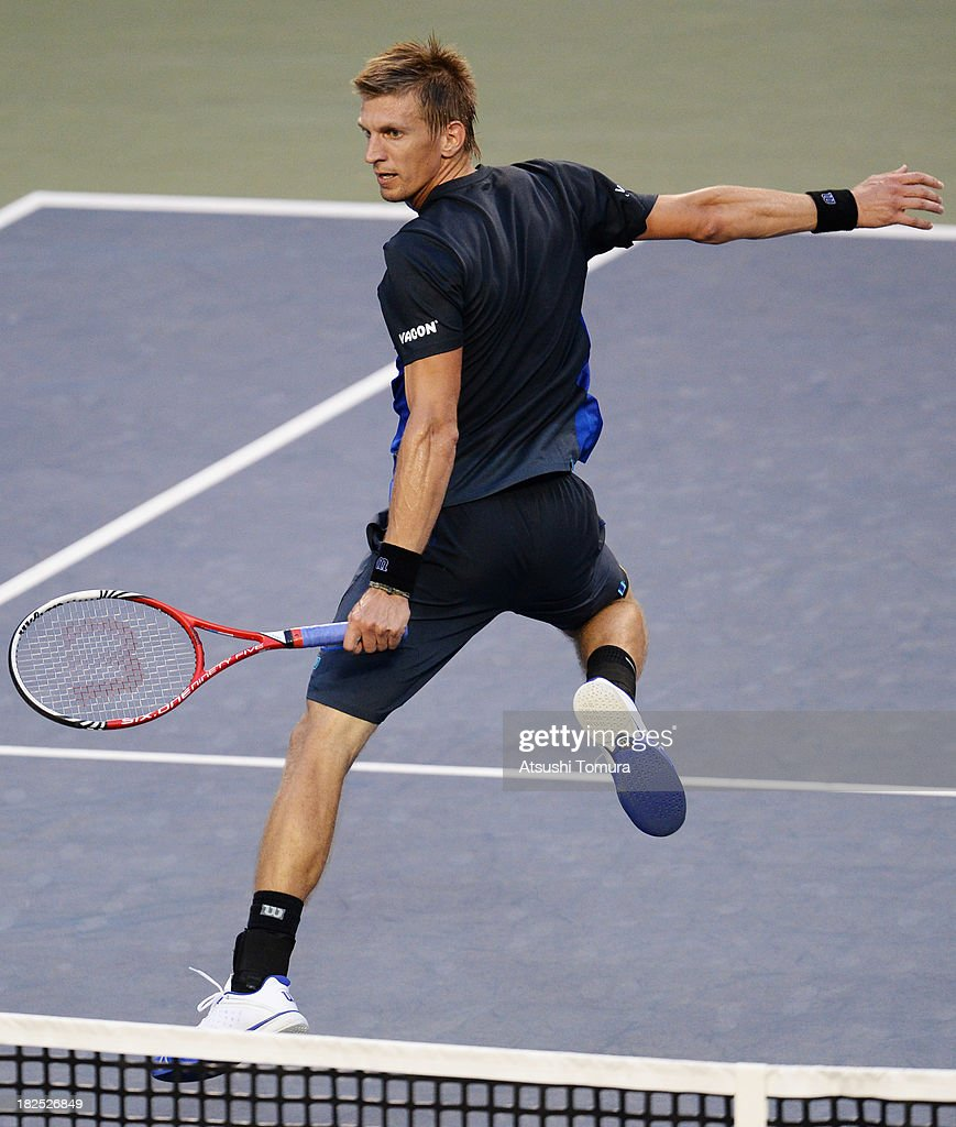 <a gi-track='captionPersonalityLinkClicked' href=/galleries/search?phrase=Jarkko+Nieminen&family=editorial&specificpeople=211396 ng-click='$event.stopPropagation()'>Jarkko Nieminen</a> of Finland in action during his men's first round match against Juan Monaco of Argentina during day one of the Rakuten Open at Ariake Colosseum on September 30, 2013 in Tokyo, Japan.