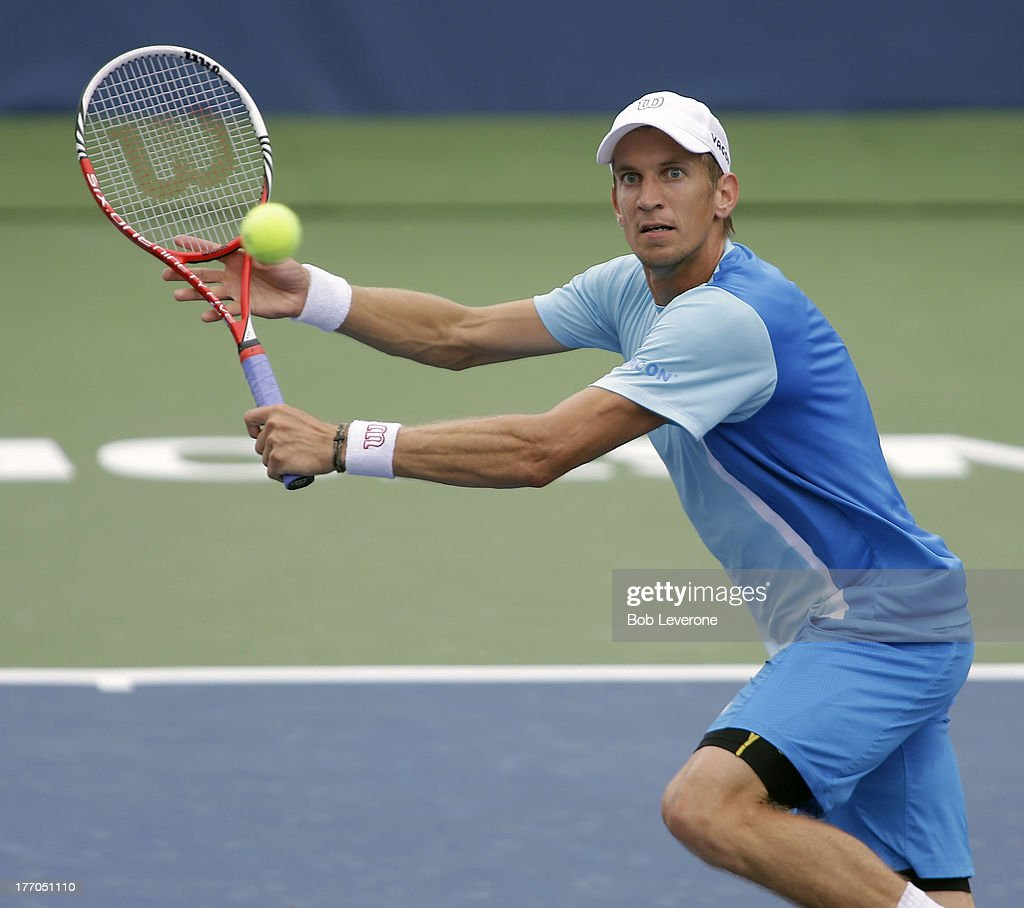 Jarkko Nieminen of Finland keeps his eye on the ball as he prepares to hit a backhand shot against Mardy Fish on August 20, 2013 in Winston Salem, North Carolina.