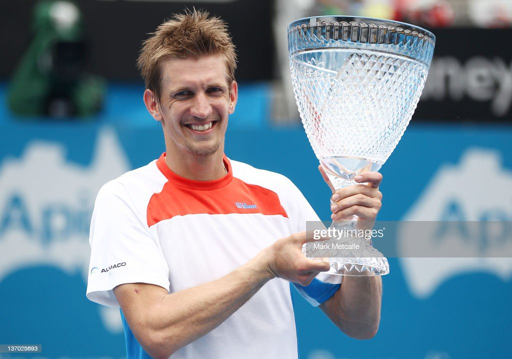 Jarkko Nieminen of Finland poses with the winners trophy after victory in the Men's final match against Julien Benneteau of France during day eight of the 2012 Sydney International at Sydney Olympic Park Tennis Centre on January 15, 2012 in Sydney, Australia.