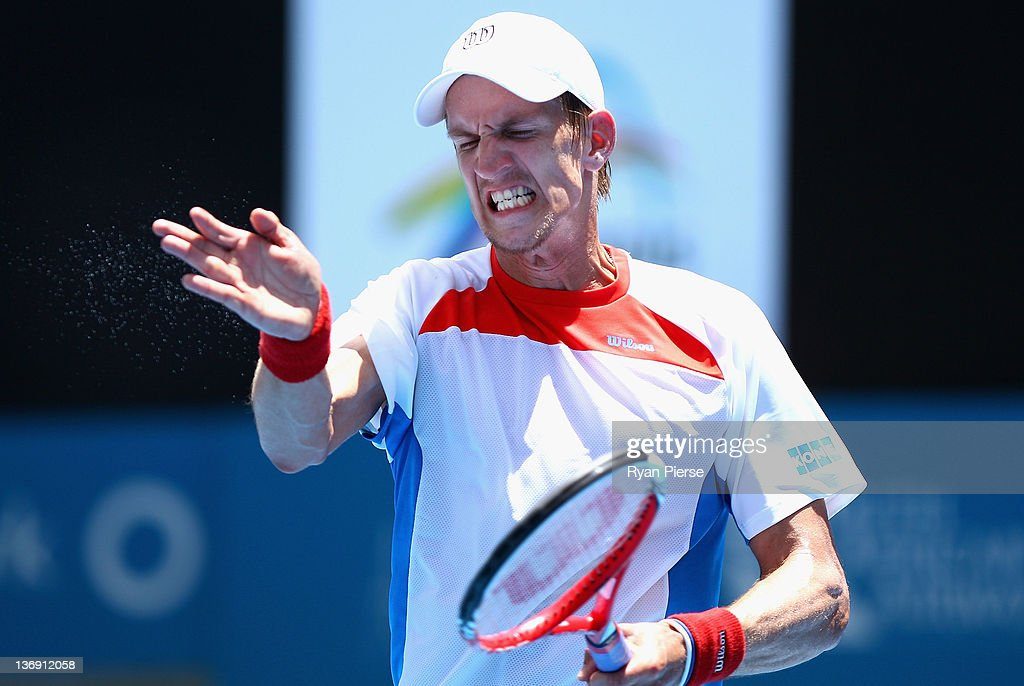 <a gi-track='captionPersonalityLinkClicked' href=/galleries/search?phrase=Jarkko+Nieminen&family=editorial&specificpeople=211396 ng-click='$event.stopPropagation()'>Jarkko Nieminen</a> of Finland reacts after missing a shot during his semi final match against Denis Istomin of Uzbekistan during day six of the 2012 Sydney International at Sydney Olympic Park Tennis Centre on January 13, 2012 in Sydney, Australia.