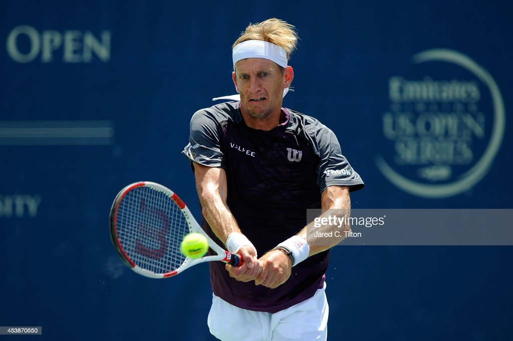 Jarkko Nieminen of Finland returns a shot from David Goffin of Belgium during the Winston-Salem Open at Wake Forest University on August 20, 2014 in Winston Salem, North Carolina.