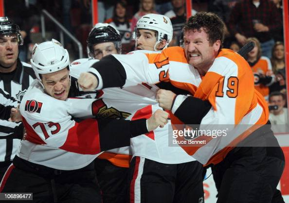 Jarkko Ruutu of the Ottawa Senators receives a punch from Scott Hartnell of the Philadelphia Flyers at the Wells Fargo Center on November 15 2010 in...