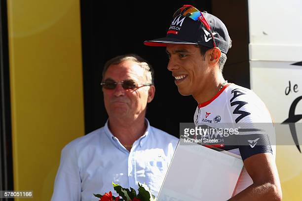 Jarlinson Pantano of Colombia and IAM Cycling alongside five times Tour winner Bernard Hinault after receiving the most competitive rider of the...