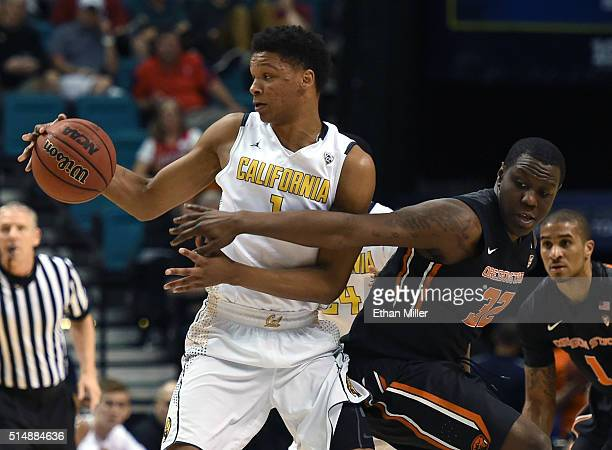 Jarmal Reid of the Oregon State Beavers tries to steal the ball from Ivan Rabb of the California Golden Bears during a quarterfinal game of the Pac12...