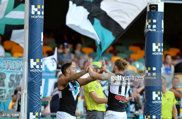 Jarman Impey of the Power celebrates kicking a goal during the round six AFL match between the Brisbane Lions and the Port Adelaide Power at The...