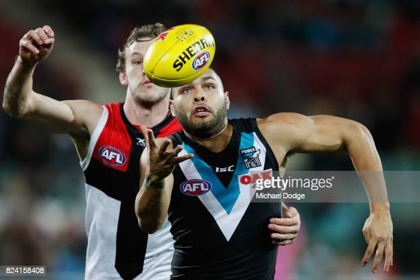 Jarman Impey of the Power gathers the ball from Jimmy Webster of the Saints during the round 19 AFL match between the Port Adelaide Power and the St...