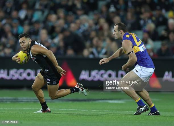 Jarman Impey of the Power gets away from Shannon Hurn of the Eagles during the round seven AFL match between the Port Adelaide Power and the West...