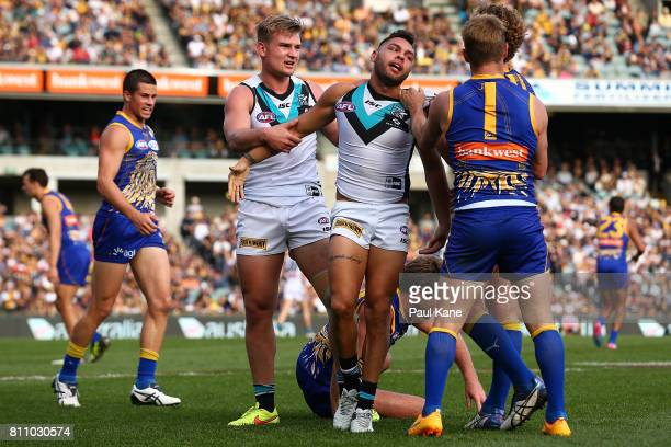 Jarman Impey of the Power is separated from a wrestle with Mark Hutchings of the Eagles during the round 16 AFL match between the West Coast Eagles...