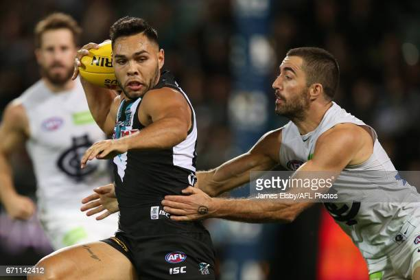 Jarman Impey of the Power is tackled by Kade Simpson of the Blues during the 2017 AFL round 05 match between Port Adelaide Power and the Carlton...