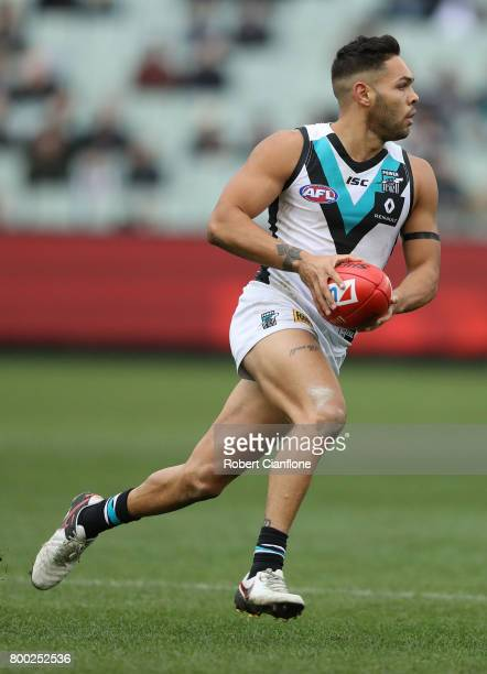 Jarman Impey of the Power runs with the ball during the round 14 AFL match between the Collingwood Magpies and the Port Adelaide Power at Melbourne...