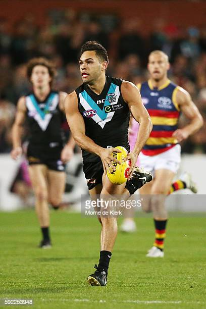 Jarman Impey of the Power runs with the ball during the round 22 AFL match between the Port Adelaide Power and the Adelaide Crows at Adelaide Oval on...