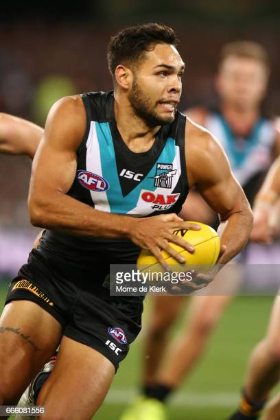 Jarman Impey of the Power runs with the ball during the round three AFL match between the Port Adelaide Power and the Adelaide Crows at Adelaide Oval...