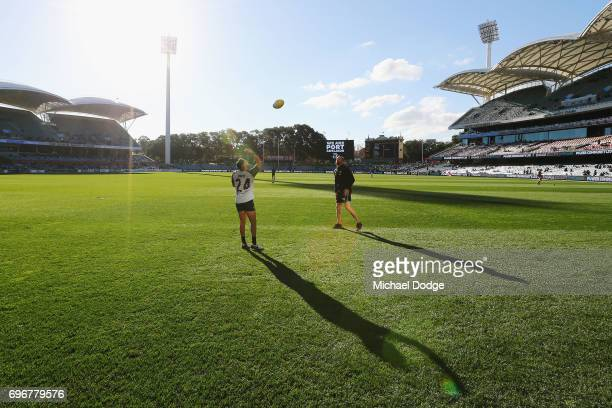 Jarman Impey of the Power warms up during the round 13 AFL match between the Port Adelaide Power and the Brisbane Lions at Adelaide Oval on June 17...