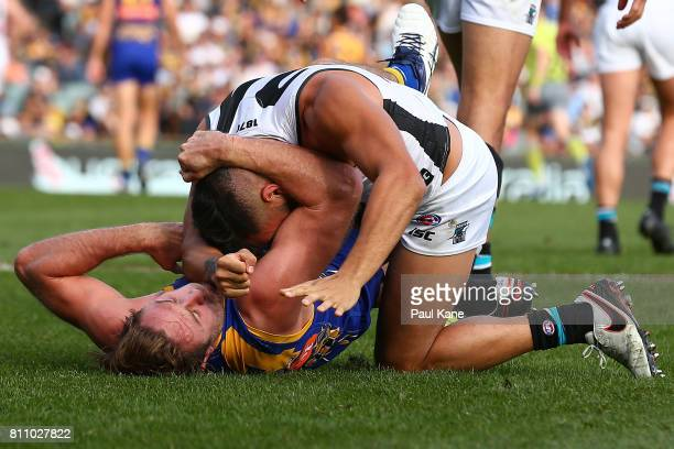 Jarman Impey of the Power wrestles with Mark Hutchings of the Eagles during the round 16 AFL match between the West Coast Eagles and the Port...