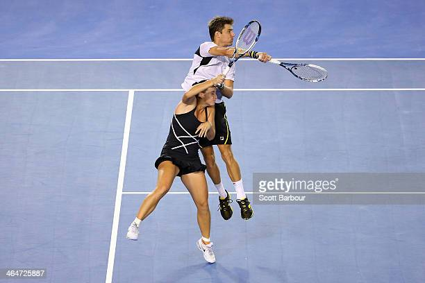 Jarmila Gajdosova of Australia and Matthew Ebden of Australia collide in their mixed doubles semifinal match against Sania Mirza of India and Horia...