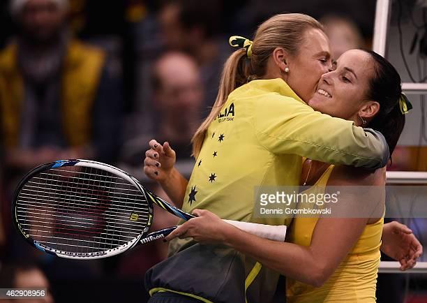 Jarmila Gajdosova of Australia celebrates with team captain Alicia Molik after her single match against Angelique Kerber of Germany during the Fed...