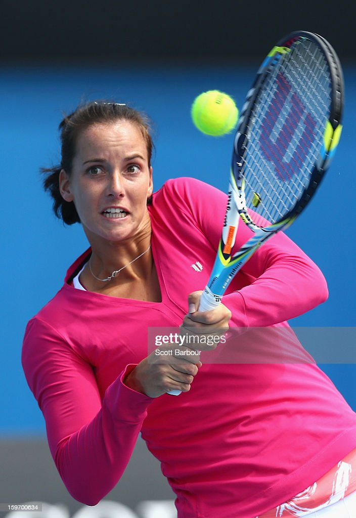 Jarmila Gajdosova of Australia plays a backhand in her first round mixed doubles match with Matthew Ebden of Australia against Sabine Lisicki of Germany and Frederik Nielsen of Denmark during day six of the 2013 Australian Open at Melbourne Park on January 19, 2013 in Melbourne, Australia.