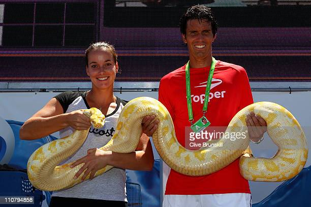 Jarmila Groth of Australia and Juan Ignacio Chela of Argentina hold a snake from the Miami Metro Zoo during the Sony Ericsson Open at Crandon Park...