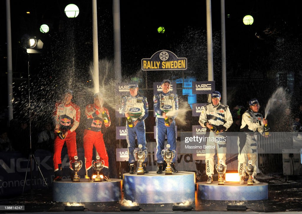 Jarmo Lehtinen of Finland and Mikko Hirvonen of Finland with Mikka Anttila of Finland and Jari Matti Latvala of Finland and Jonas Andersson of Sweden and Mats Ostberg of Norway celebrate on the podium during Day 3 of the WRC Rally Sweden on February 12, 2012 in Karlstad, Sweden.