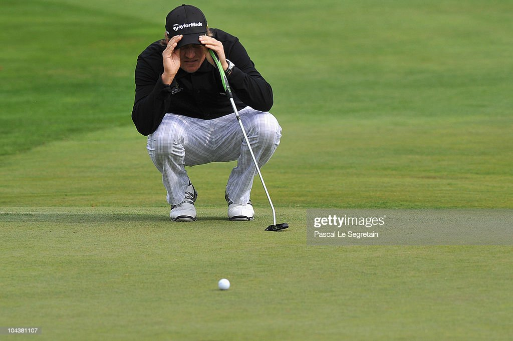 Jarmo Sandelin of Sweden lines up his putt on the third hole during day one of the Vivendi Cup at Joyenval golf course on September 23 2010 in Paris...