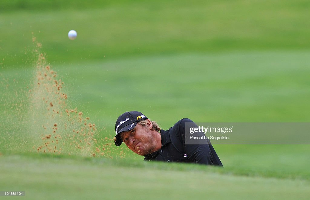 Jarmo Sandelin of Sweden plays a bunker shot on the 3rd hole during day one of the Vivendi Cup at Joyenval golf course on September 23 2010 in Paris...