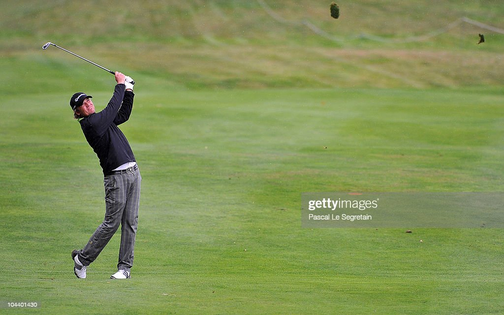 Jarmo Sandelin of Sweden plays his second shot at the eighteenth hole during day two of the Vivendi cup at Joyenval Golf course on September 24 2010...