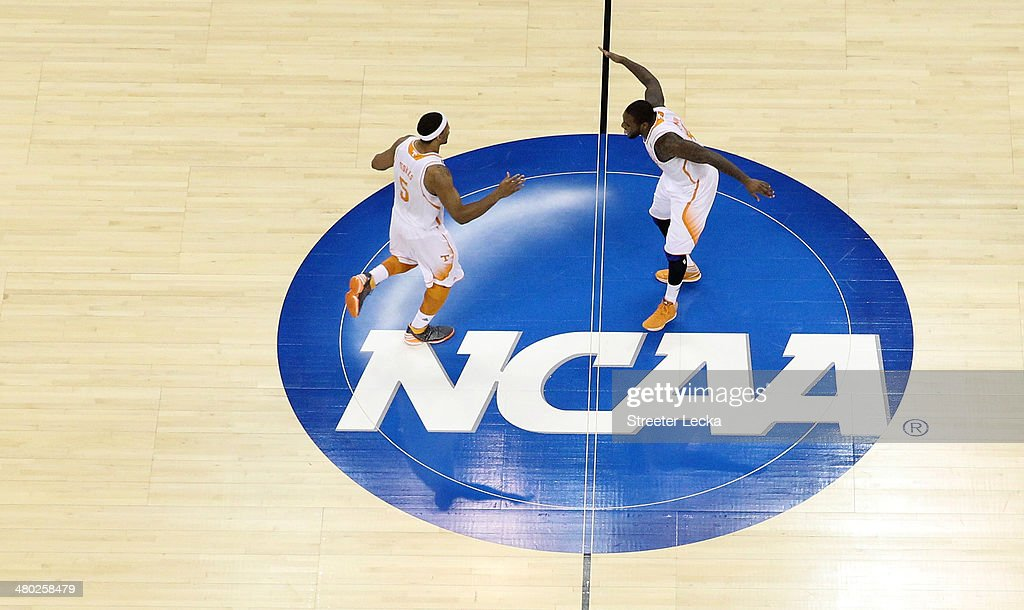 Jarnell Stokes #5 and Jeronne Maymon #34 of the Tennessee Volunteers celebrate at center court against the Mercer Bears during the third round of the 2014 NCAA Men's Basketball Tournament at PNC Arena on March 23, 2014 in Raleigh, North Carolina.