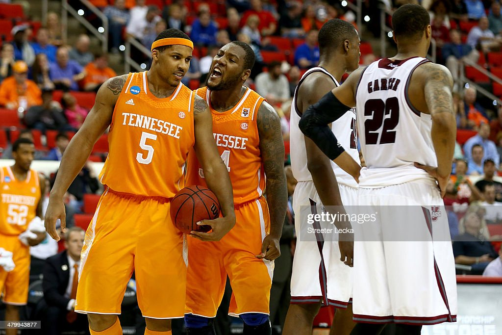 Jarnell Stokes #5 and Jeronne Maymon #34 of the Tennessee Volunteers react in the second half while taking on the Massachusetts Minutemen in the second round of the 2014 NCAA Men's Basketball Tournament at PNC Arena on March 21, 2014 in Raleigh, North Carolina.