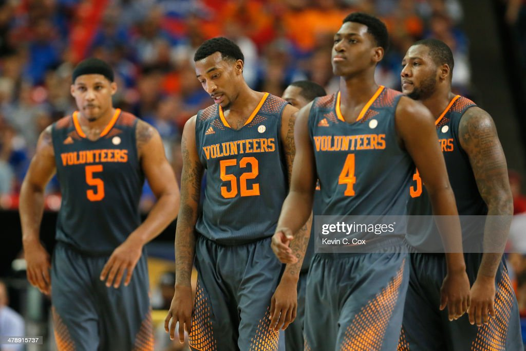 Jarnell Stokes #5, Jordan McRae #52, Armani Moore #4, and Jeronne Maymon #34 of the Tennessee Volunteers after a technical foul called against Maymon during the semifinals of the SEC Men's Basketball Tournament against the Florida Gators at Georgia Dome on March 15, 2014 in Atlanta, Georgia.