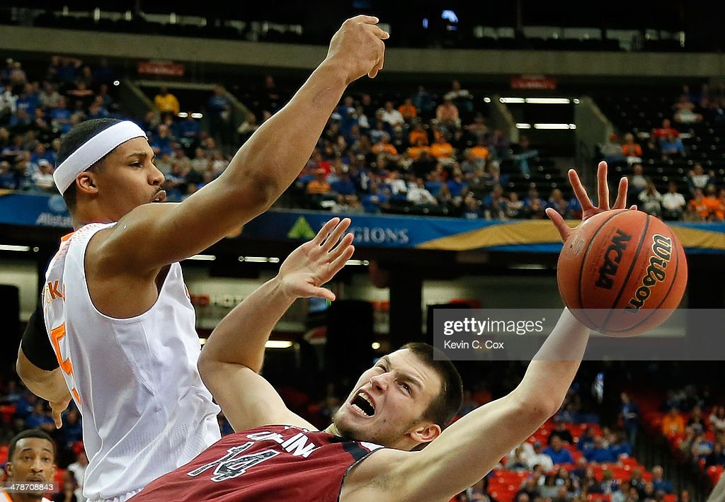Jarnell Stokes #5 of the Tennessee Volunteers battles for a rebound against Laimonas Chatkevicius #14 of the South Carolina Gamecocks during the quarterfinals of the SEC Men's Basketball Tournament at Georgia Dome on March 14, 2014 in Atlanta, Georgia.