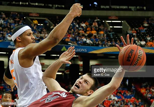 Jarnell Stokes of the Tennessee Volunteers battles for a rebound against Laimonas Chatkevicius of the South Carolina Gamecocks during the...