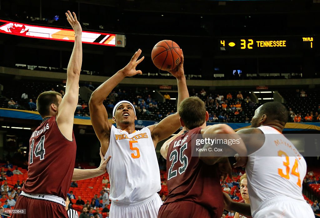 Jarnell Stokes #5 of the Tennessee Volunteers drives against Laimonas Chatkevicius #14 and Mindaugas Kacinas #25 of the South Carolina Gamecocks during the quarterfinals of the SEC Men's Basketball Tournament at Georgia Dome on March 14, 2014 in Atlanta, Georgia.