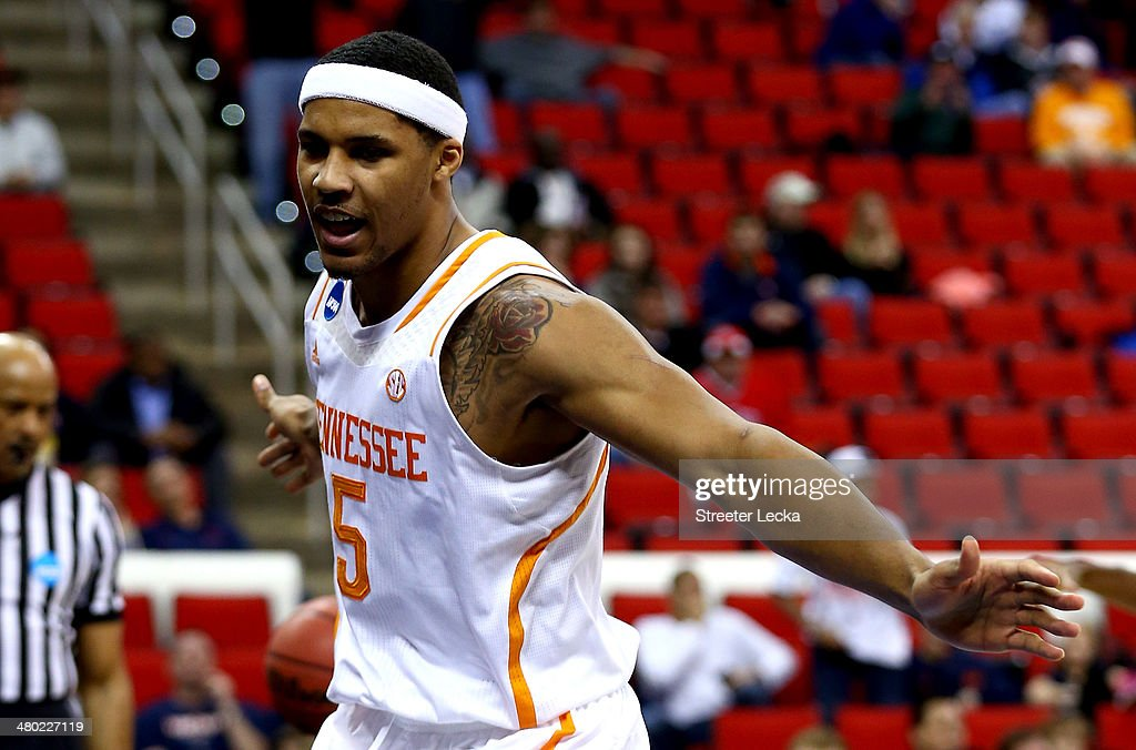 <a gi-track='captionPersonalityLinkClicked' href=/galleries/search?phrase=Jarnell+Stokes&family=editorial&specificpeople=8795785 ng-click='$event.stopPropagation()'>Jarnell Stokes</a> #5 of the Tennessee Volunteers reacts after a basket in the first half against the Mercer Bears during the third round of the 2014 NCAA Men's Basketball Tournament at PNC Arena on March 23, 2014 in Raleigh, North Carolina.