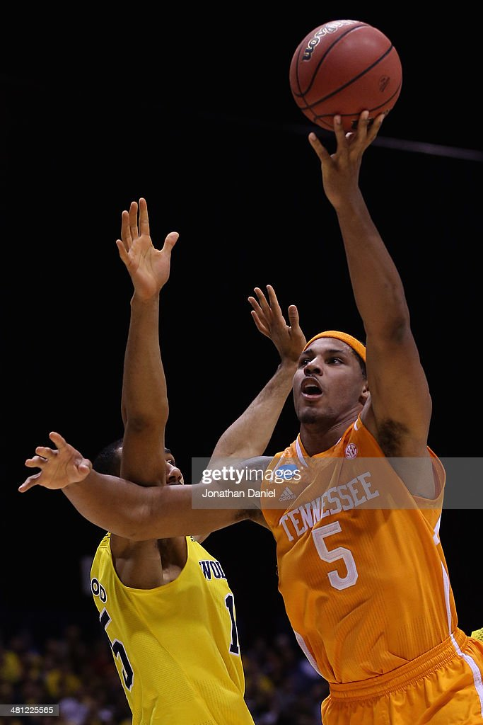 Jarnell Stokes #5 of the Tennessee Volunteers shoots the ball against Jon Horford #15 of the Michigan Wolverines during the regional semifinal of the 2014 NCAA Men's Basketball Tournament at Lucas Oil Stadium on March 28, 2014 in Indianapolis, Indiana.