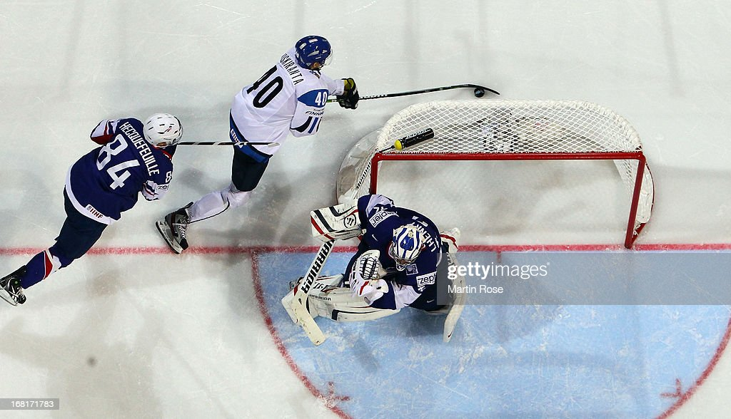 Jarno Koskiranta (#40) of Finland and Kevin Hecquefeuille (#84) of France battle for the puck during the IIHF World Championship group H match between Finland and France at Hartwall Areena on May 6, 2013 in Helsinki, Finland.