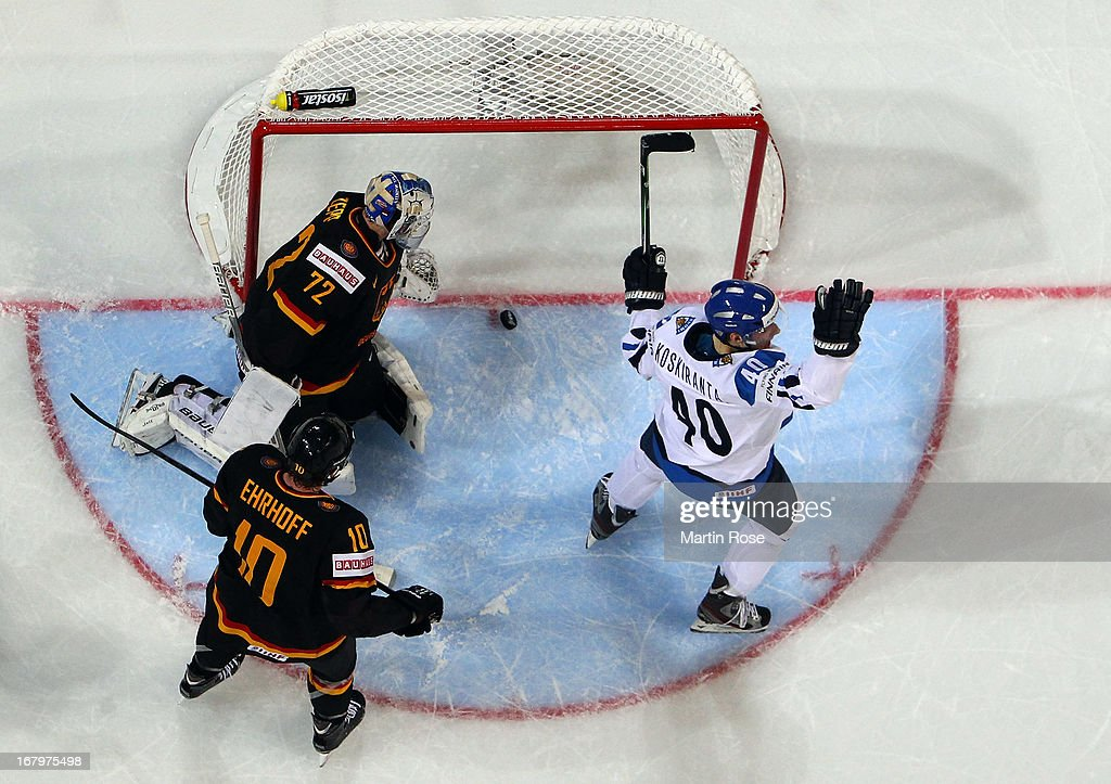 Jarno Koskiranta (#40) of Finland celebrates after he scores his team's 2nd goal over <a gi-track='captionPersonalityLinkClicked' href=/galleries/search?phrase=Rob+Zepp&family=editorial&specificpeople=3121630 ng-click='$event.stopPropagation()'>Rob Zepp</a> (C), goaltender of Germany during the IIHF World Championship group H match between Finland and Germany at Hartwall Areena on May 3, 2013 in Helsinki, Finland.