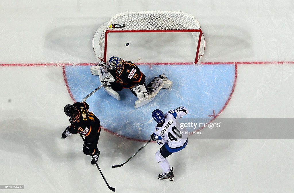 Jarno Koskiranta (#40) of Finland scores his team's 2nd goal over <a gi-track='captionPersonalityLinkClicked' href=/galleries/search?phrase=Rob+Zepp&family=editorial&specificpeople=3121630 ng-click='$event.stopPropagation()'>Rob Zepp</a> (C), goaltender of Germany during the IIHF World Championship group H match between Finland and Germany at Hartwall Areena on May 3, 2013 in Helsinki, Finland.