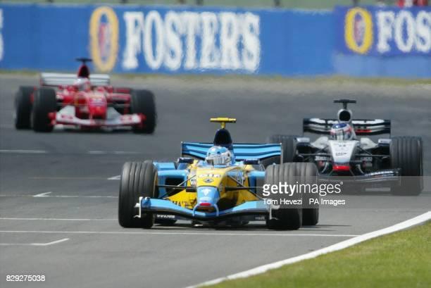 Jarno Trulli in his Renault leads from Kimi Raikkonen in his McLaren and 3rd Rubens Barichello in his Ferrari on the 4th lap at the British Grand...