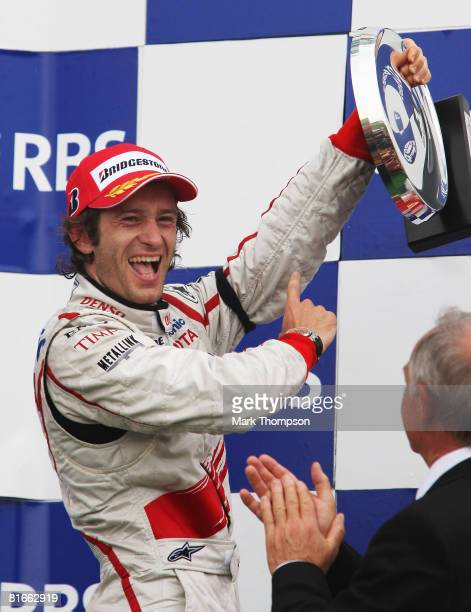 Jarno Trulli of Italy and Toyota celebrates on the podium after finishing third during the French Formula One Grand Prix at the Circuit de Nevers...
