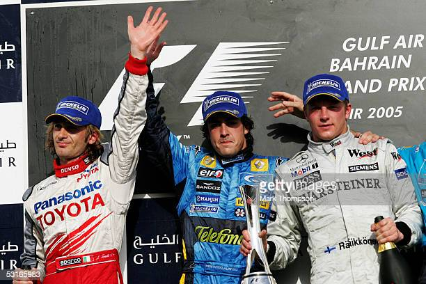Jarno Trulli of Italy and Toyota Fernando Alonso of Spain and Renault and Kimi Raikkonen of Finland and McLaren Mercedes on the podium after the...