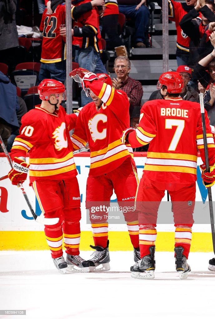 <a gi-track='captionPersonalityLinkClicked' href=/galleries/search?phrase=Jarome+Iginla&family=editorial&specificpeople=201792 ng-click='$event.stopPropagation()'>Jarome Iginla</a> #12; <a gi-track='captionPersonalityLinkClicked' href=/galleries/search?phrase=Alex+Tanguay&family=editorial&specificpeople=203231 ng-click='$event.stopPropagation()'>Alex Tanguay</a> #40 and TJ Brodie #7 of the Calgary Flames celebrate a goal against the Phoenix Coyotes on February 24, 2013 at the Scotiabank Saddledome in Calgary, Alberta, Canada.