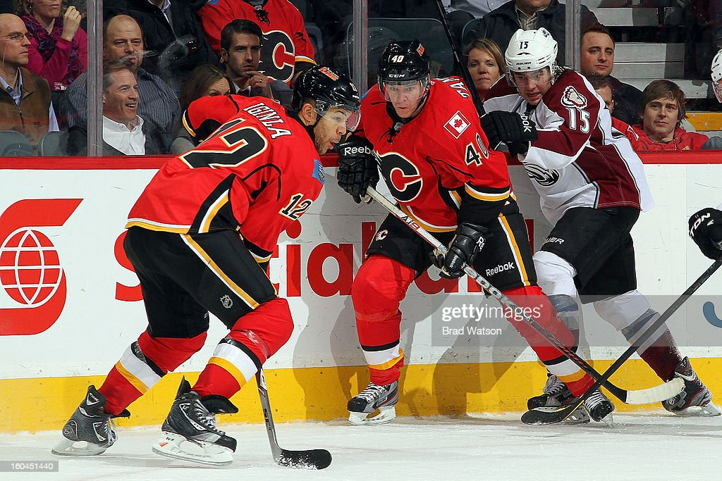 <a gi-track='captionPersonalityLinkClicked' href=/galleries/search?phrase=Jarome+Iginla&family=editorial&specificpeople=201792 ng-click='$event.stopPropagation()'>Jarome Iginla</a> #12 and <a gi-track='captionPersonalityLinkClicked' href=/galleries/search?phrase=Alex+Tanguay&family=editorial&specificpeople=203231 ng-click='$event.stopPropagation()'>Alex Tanguay</a> #40 of the Calgary Flames skate against <a gi-track='captionPersonalityLinkClicked' href=/galleries/search?phrase=P.A.+Parenteau&family=editorial&specificpeople=5537244 ng-click='$event.stopPropagation()'>P.A. Parenteau</a> #15 of the Colorado Avalanche on January 31, 2013 at the Scotiabank Saddledome in Calgary, Alberta, Canada.
