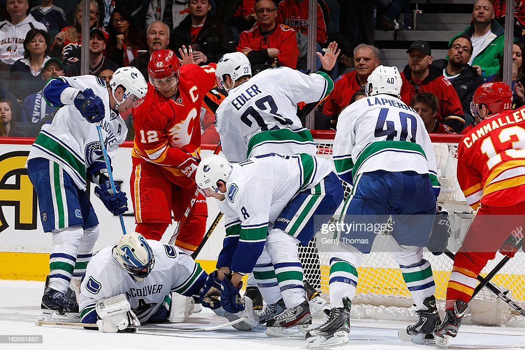 <a gi-track='captionPersonalityLinkClicked' href=/galleries/search?phrase=Jarome+Iginla&family=editorial&specificpeople=201792 ng-click='$event.stopPropagation()'>Jarome Iginla</a> #12 and Michael Cammalleri #13 of the Calgary Flames skate against the Vancouver Canucks on March 3, 2013 at the Scotiabank Saddledome in Calgary, Alberta, Canada.