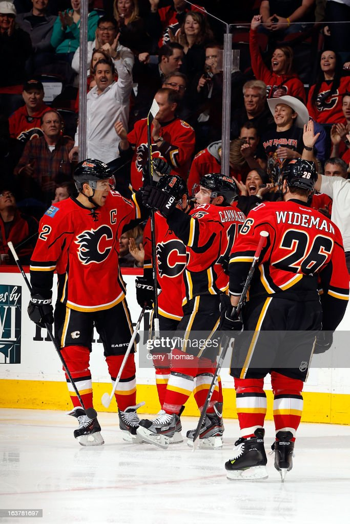 <a gi-track='captionPersonalityLinkClicked' href=/galleries/search?phrase=Jarome+Iginla&family=editorial&specificpeople=201792 ng-click='$event.stopPropagation()'>Jarome Iginla</a> #12, Michael Cammalleri #13, <a gi-track='captionPersonalityLinkClicked' href=/galleries/search?phrase=Dennis+Wideman&family=editorial&specificpeople=575234 ng-click='$event.stopPropagation()'>Dennis Wideman</a> #26 and teammates of the Calgary Flames celebrate a goal against the Nashville Predators on March 15, 2013 at the Scotiabank Saddledome in Calgary, Alberta, Canada.