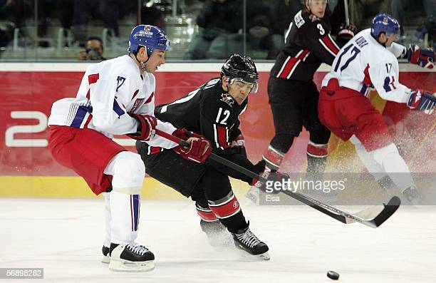 Jarome Iginla of Canada and Frantisek Kaberle of the Czech Republic fight for control of the puck during the men's ice hockey Preliminary Round Group...