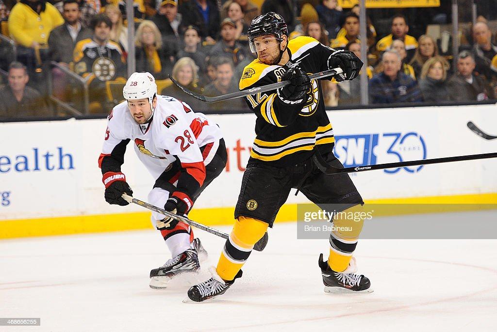 Jarome Iginla of the Boston Bruins against Matt Kassian of the Ottawa Senators at the TD Garden on February 8 2014 in Boston Massachusetts