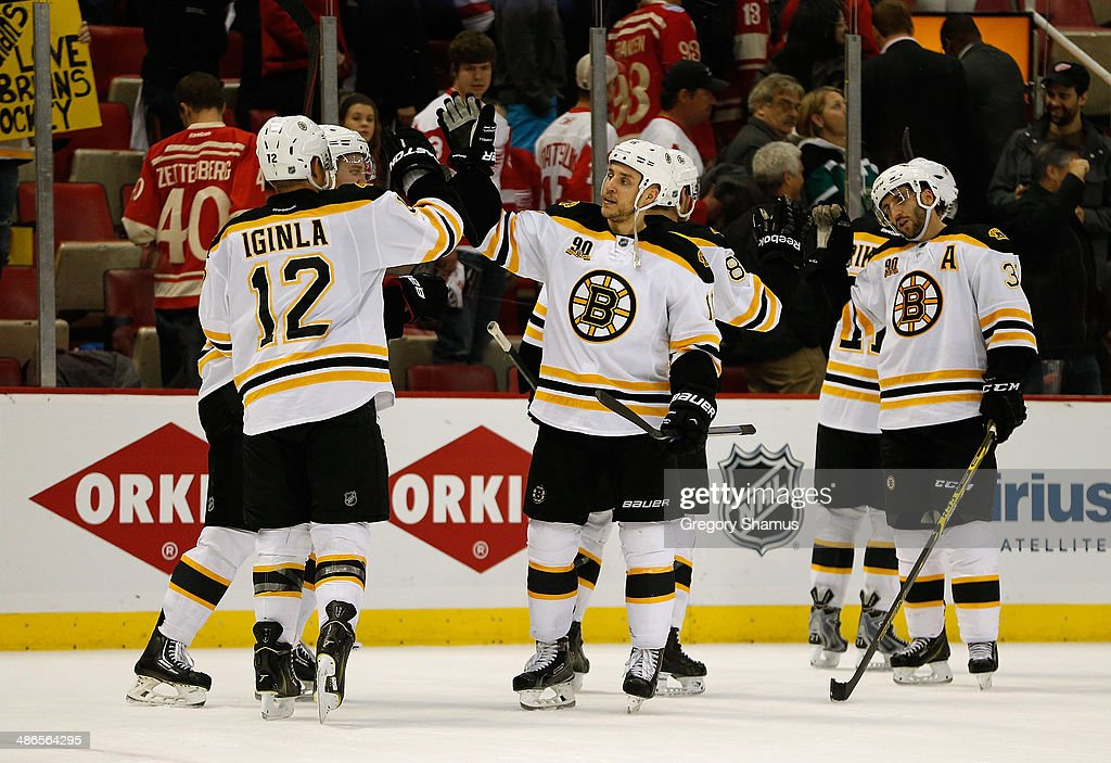 <a gi-track='captionPersonalityLinkClicked' href=/galleries/search?phrase=Jarome+Iginla&family=editorial&specificpeople=201792 ng-click='$event.stopPropagation()'>Jarome Iginla</a> #12 of the Boston Bruins celebrates his game-winning overtime goal with <a gi-track='captionPersonalityLinkClicked' href=/galleries/search?phrase=Gregory+Campbell&family=editorial&specificpeople=640895 ng-click='$event.stopPropagation()'>Gregory Campbell</a> #11 to beat the Detroit Red Wings 3-2 in Game Four of the First Round of the 2014 NHL Stanley Cup Playoffs at Joe Louis Arena on April 24, 2014 in Detroit, Michigan.