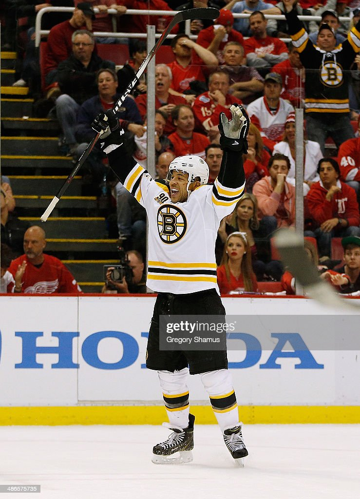 <a gi-track='captionPersonalityLinkClicked' href=/galleries/search?phrase=Jarome+Iginla&family=editorial&specificpeople=201792 ng-click='$event.stopPropagation()'>Jarome Iginla</a> #12 of the Boston Bruins celebrates his game-winning overtime goal to beat the Detroit Red Wings 3-2 in Game Four of the First Round of the 2014 NHL Stanley Cup Playoffs at Joe Louis Arena on April 24, 2014 in Detroit, Michigan.
